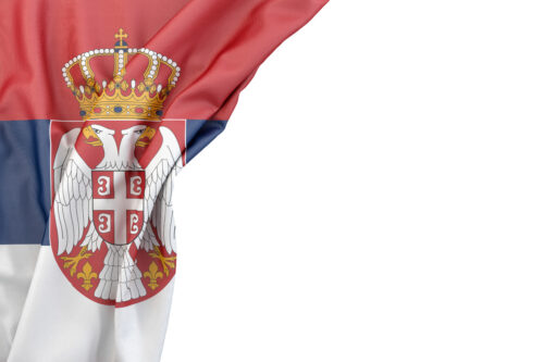 Flag of Serbia in the corner on white background. Isolated, contains clipping path - slon.pics - free stock photos and illustrations