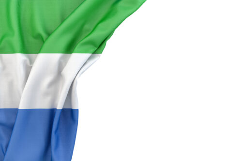 Flag of Sierra Leone in the corner on white background. Isolated, contains clipping path - slon.pics - free stock photos and illustrations