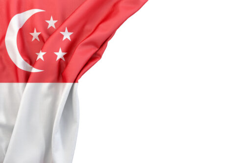 Flag of Singapore in the corner on white background. Isolated, contains clipping path - slon.pics - free stock photos and illustrations