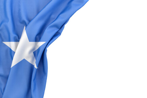Flag of Somalia Islands in the corner on white background. Isolated, contains clipping path - slon.pics - free stock photos and illustrations