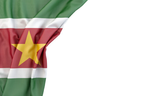 Flag of Suriname in the corner on white background. Isolated, contains clipping path - slon.pics - free stock photos and illustrations