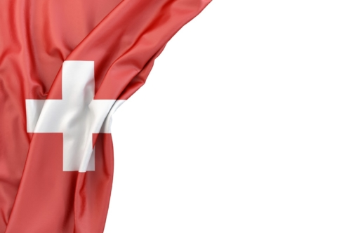 Flag of Switzerland in the corner on white background. Isolated, contains clipping path - slon.pics - free stock photos and illustrations