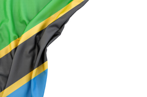 Flag of Tanzania in the corner on white background. Isolated, contains clipping path - slon.pics - free stock photos and illustrations