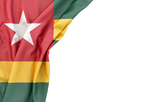Flag of Togo in the corner on white background. Isolated, contains clipping path - slon.pics - free stock photos and illustrations