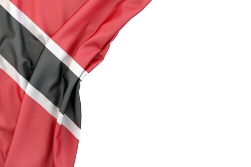 Flag of Trinidad and Tobago in the corner on white background. Isolated, contains clipping path - slon.pics - free stock photos and illustrations
