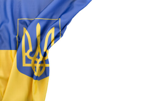 Flag of Ukraine with coat of arms in the corner on white background. Isolated, contains clipping path - slon.pics - free stock photos and illustrations