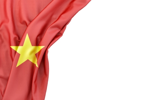 Flag of Vietnam in the corner on white background. Isolated, contains clipping path - slon.pics - free stock photos and illustrations