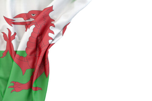 Flag of Wales in the corner on white background. Isolated, contains clipping path - slon.pics - free stock photos and illustrations