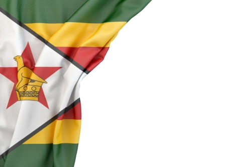 Flag of Zimbabwe in the corner on white background. Isolated, contains clipping path - slon.pics - free stock photos and illustrations