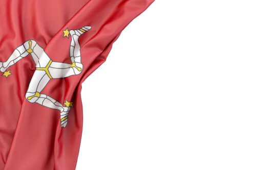 Flag of the Isle of Man in the corner on white background. Isolated, contains clipping path - slon.pics - free stock photos and illustrations