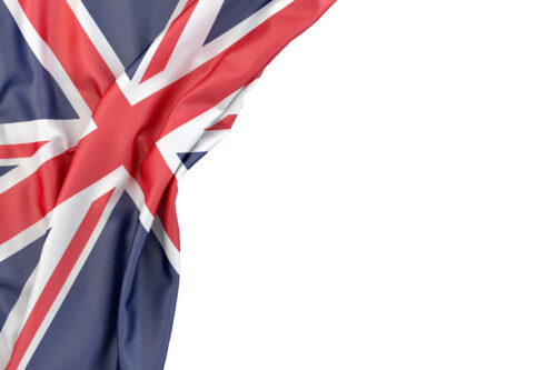 Flag of the United Kingdom in the corner on white background. Isolated, contains clipping path - slon.pics - free stock photos and illustrations