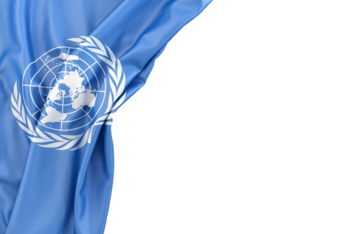 Flag of the United Nations in the corner on white background. Isolated, contains clipping path - slon.pics - free stock photos and illustrations