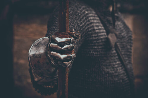 Knight's hand in metal gloves holding spear - slon.pics - free stock photos and illustrations