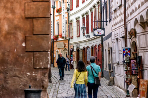 People walking through the historic town of Cesky Krumlov, Czech Republic. September 06, 2016 - slon.pics - free stock photos and illustrations