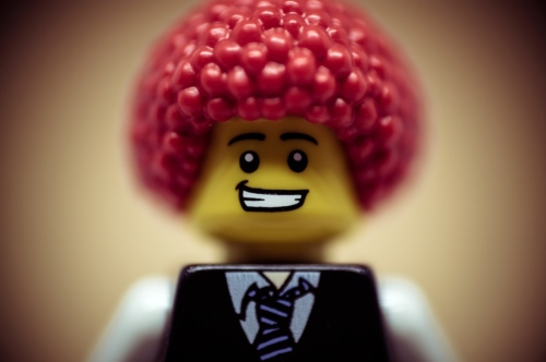 Portrait of a happy smiling businessman with clown wig - slon.pics - free stock photos and illustrations