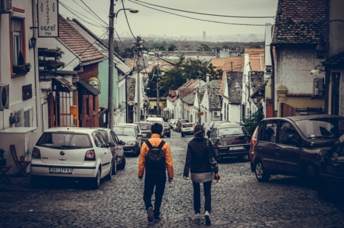 Traveling couple walking through old town of Zemun. Republic of Serbia - slon.pics - free stock photos and illustrations