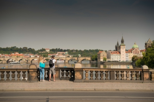 Undefined travelers with backpacks taking photos of Prague at Legion Bridge (Most Legii). Czech Republic - slon.pics - free stock photos and illustrations
