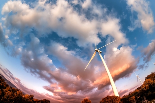 Wind turbine against a dramatic, cloudy, evening sky - slon.pics - free stock photos and illustrations