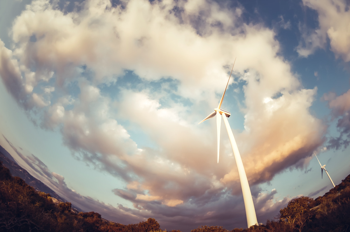 Wind turbine against cloudy sky - slon.pics - free stock photos and illustrations