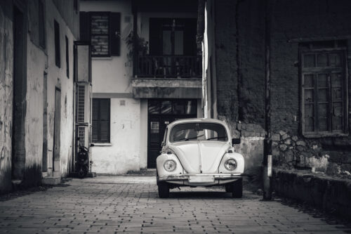 Old car parked in front of house wall - slon.pics - free stock photos and illustrations