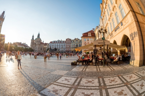 People resting in street cafes at Old town square. Prague, Czech Republic - slon.pics - free stock photos and illustrations