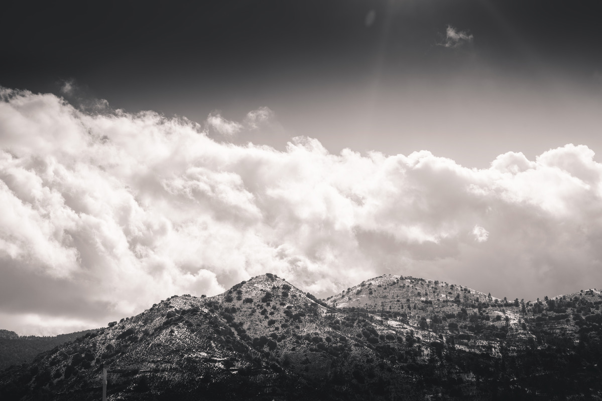 Snow-capped mountain peak against cloudy sky - slon.pics - free stock photos and illustrations