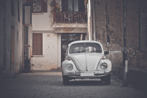 A vintage car parked on the street - slon.pics - free stock photos and illustrations