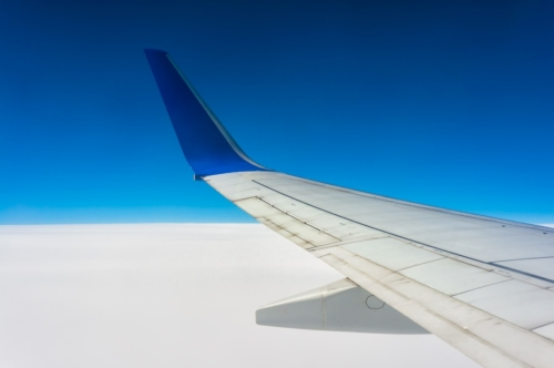 Airplane wing over white clouds - slon.pics - free stock photos and illustrations