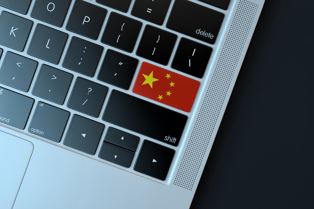 Chinese flag over computer keyboard - slon.pics - free stock photos and illustrations