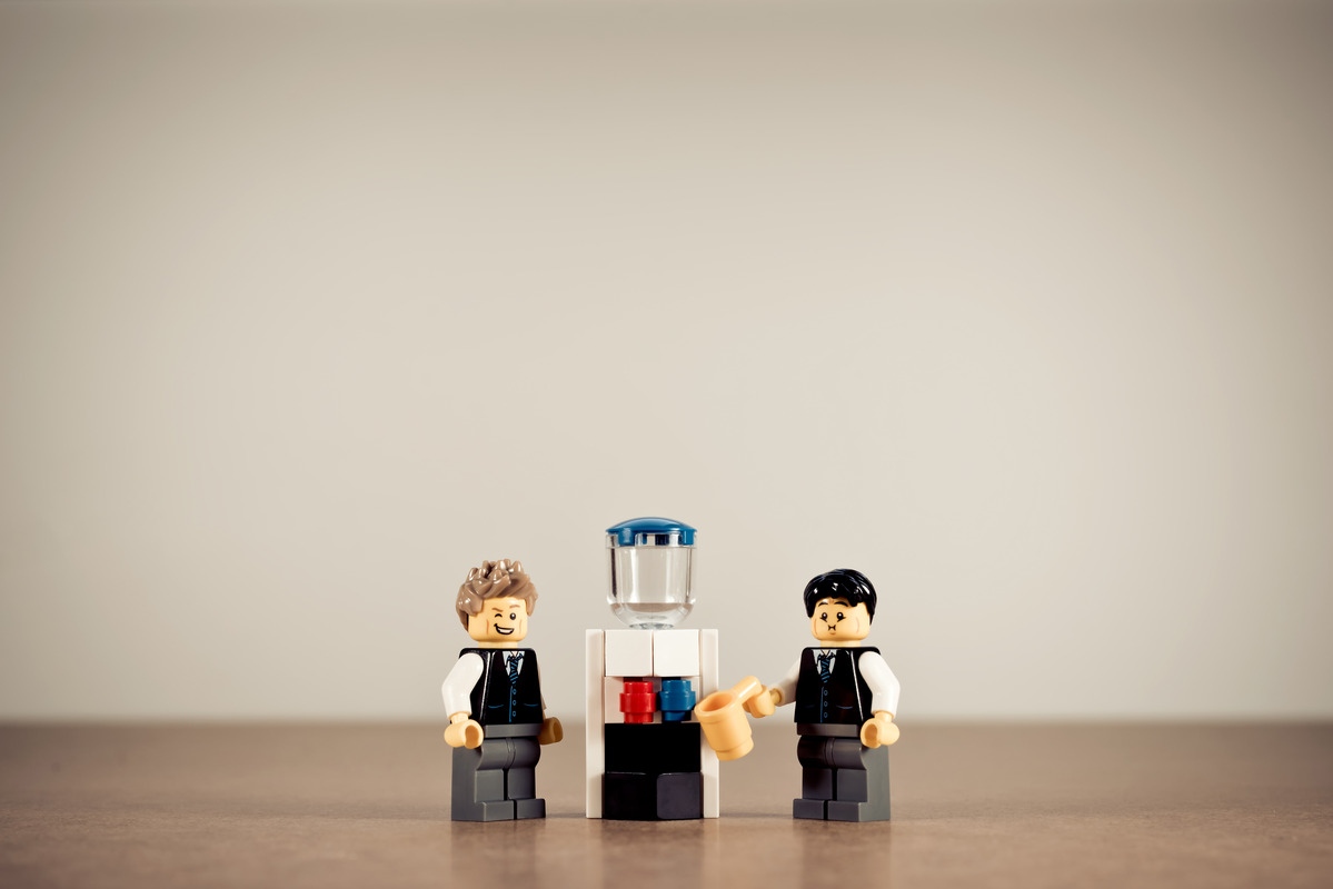 Colleagues talking at water cooler - slon.pics - free stock photos and illustrations