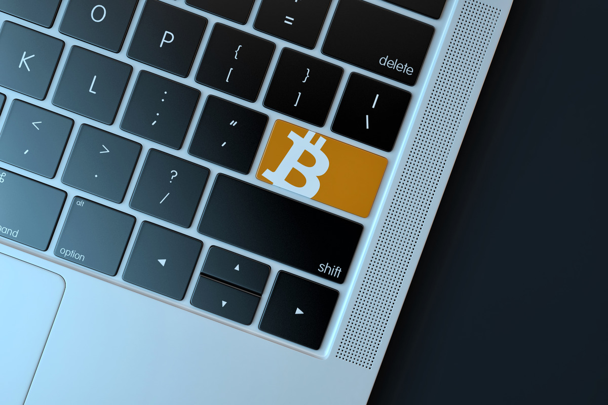 Bitcoin icon on laptop keyboard. Technology concept - slon.pics - free stock photos and illustrations