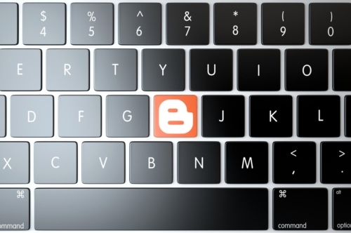 Blogger icon on laptop keyboard. Technology concept - slon.pics - free stock photos and illustrations