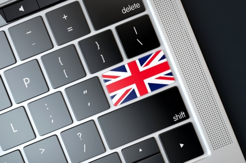 Flag of UK over computer keyboard. Technology concept - slon.pics - free stock photos and illustrations