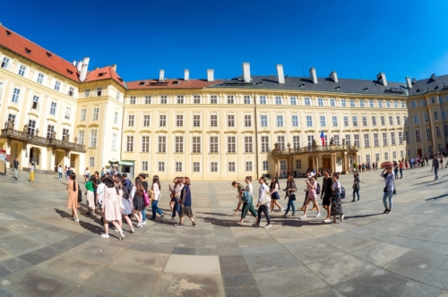 Group of tourists in the third courtyard of Prague Castle. Prague, Czech Republic, May 18, 2017 - slon.pics - free stock photos and illustrations