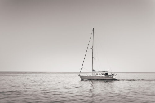 Lonely sailboat in a calm sea - slon.pics - free stock photos and illustrations