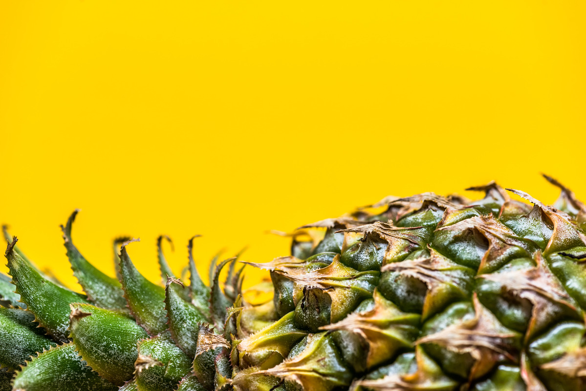 Lying pineapple on simple yellow background - slon.pics - free stock photos and illustrations
