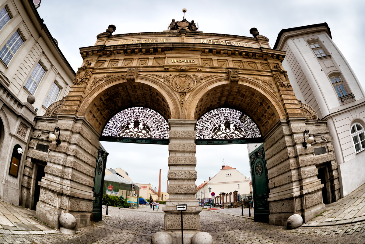 Main gate of the Pilsner Urquell Brewery. Plzen (Pilsen), Czech Republic, May 22, 2017 - slon.pics - free stock photos and illustrations