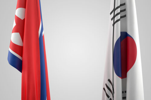 North Korea and South Korea Flags. Geopolitical concept. 3D illustration. Contains clipping path - slon.pics - free stock photos and illustrations