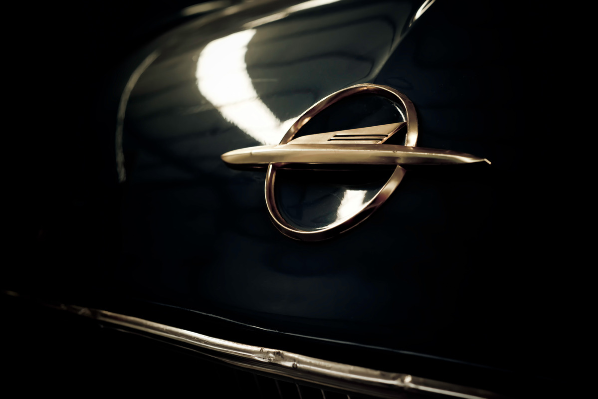 Old Opel Logo on the rear of a 1960 Rekord - slon.pics - free stock photos and illustrations