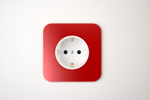 Red power socket on white wall - slon.pics - free stock photos and illustrations