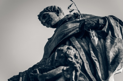 Statue of St. Nicholas of Tolentino on Charles Bridge. Prague, Czech Republic - slon.pics - free stock photos and illustrations