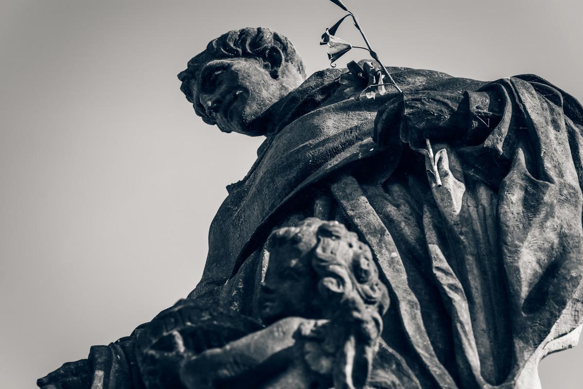 Statue of St. Nicholas of Tolentino on Charles Bridge. Prague, Czech Republic - slon.pics - free stock photos and illustrations