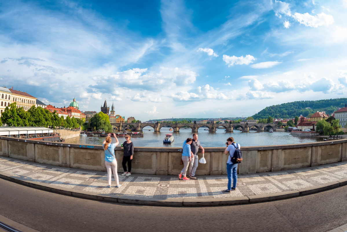 Undefinable tourists taking pictures at Manes Bridge (Manesuv most). Prague, Czech Republic - slon.pics - free stock photos and illustrations