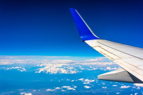 Wing of airplane flying above the clouds - slon.pics - free stock photos and illustrations