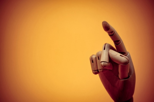 Wooden dummy hand pointing at invisible object - slon.pics - free stock photos and illustrations