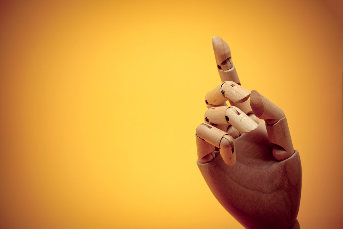 Wooden mannequin hand pointing or touching invisible object - slon.pics - free stock photos and illustrations