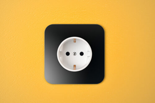 Black receptacle on yellow wall - slon.pics - free stock photos and illustrations