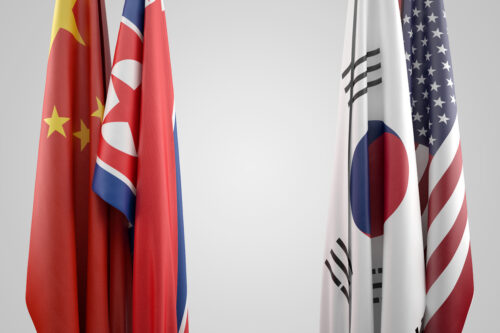 Flags of USA, China, South and North Korea. Political confrontation concept - slon.pics - free stock photos and illustrations