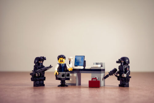 Police in the office. Business concept - slon.pics - free stock photos and illustrations