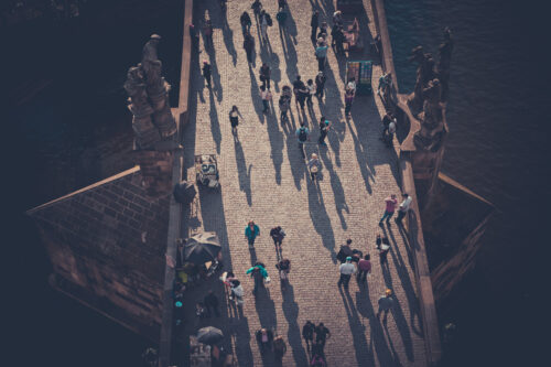 Crowd of tourists at the Charles Bridge (Karluv most), viewed from above. Prague, Czech Republic - slon.pics - free stock photos and illustrations
